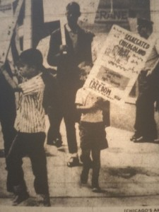 Robin picketing and holding a poster his mother, Jean Birkenstein Washington, designed